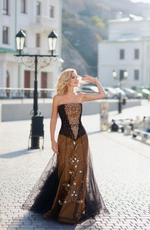 chic woman: Woman in vintage dress walking along the promenade of Balaklava Stock Photo