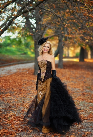 A woman walks in autumn park photo