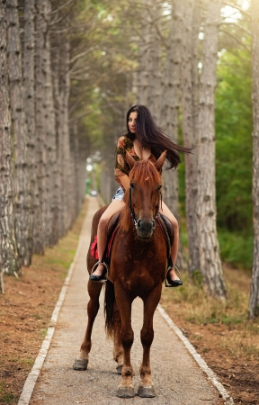 caresses: woman with a horse outdoor