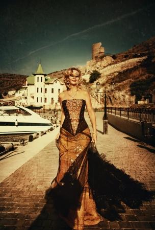 Woman in vintage dress walking along the promenade of Balaklava Stock Photo - 17743228