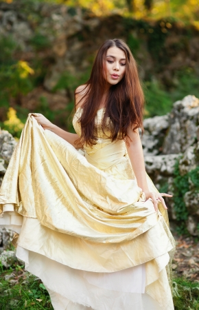 A girl in a colorful dress and the ruins of ancient Chersonese Stock Photo - 18124193