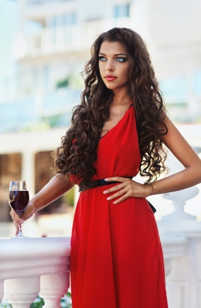 Sexy young beauty woman in red dress photo