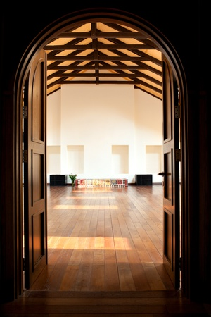 open doors: Arch with two doors leading into a large light hall