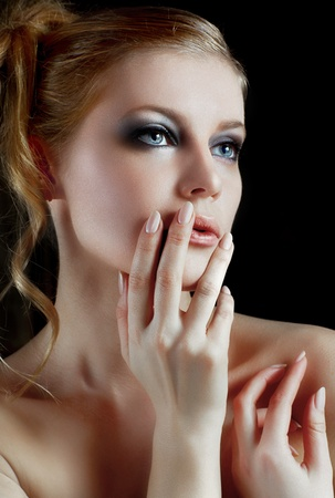 A portrait of a young woman with naked shoulders over the black Stock Photo - 10347691