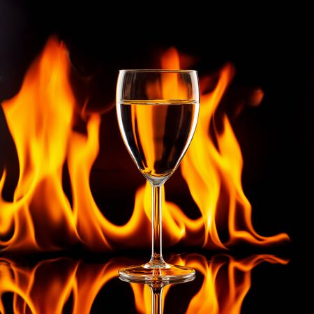 wine glass on black with flames