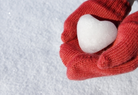 mittens: red mittens with snow heart Stock Photo