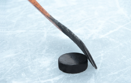 hockey puck: ice hockey stick and puck on ice Stock Photo