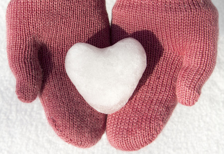 pink mittens with snow heart photo