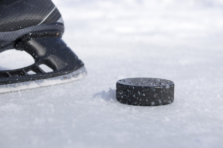 hockey skate and puck photo