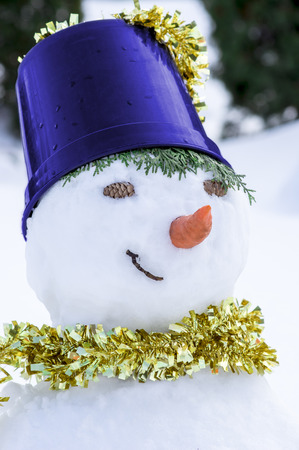 snowman with a golden scarf