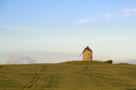 Windmill at sunset in france 写真素材