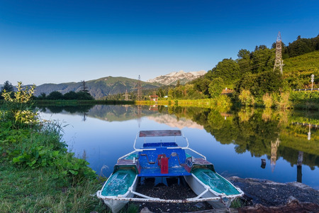 tree line: The lake near the road in the mountains of the North Caucasus.