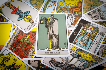 parapsychology: Tarot cards Tarot, the hermit card in the foreground.