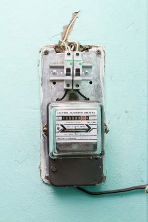 electricity meter: The electricity meter on the wall shows the electricity consumption.