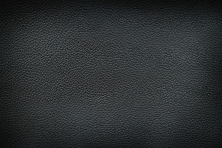 leatherette: Texture of old crumpled black leather. The dark background.