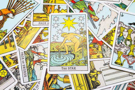 cartomancy: Tarot cards Tarot, the star card in the foreground.