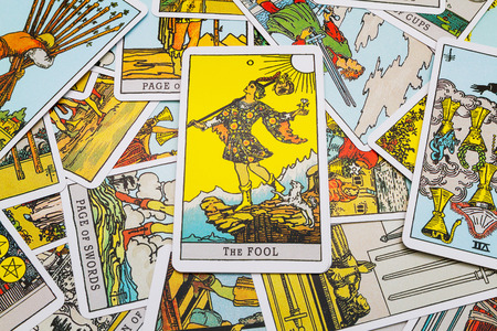 deck of cards: Tarot cards Tarot, the fool card in the foreground. Stock Photo
