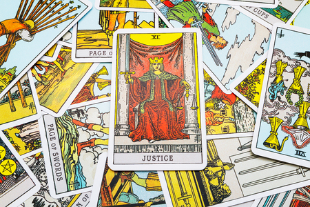 parapsychology: Tarot cards Tarot, the ustice card in the foreground. Stock Photo
