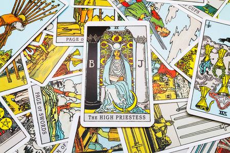 Tarot cards Tarot, the high priestess  card in the foreground.