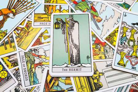 parapsychology: Tarot cards Tarot, the hermit  card in the foreground. Stock Photo