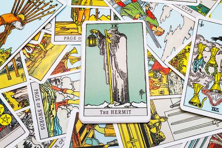 cartomancy: Tarot cards Tarot, the hermit  card in the foreground. Stock Photo