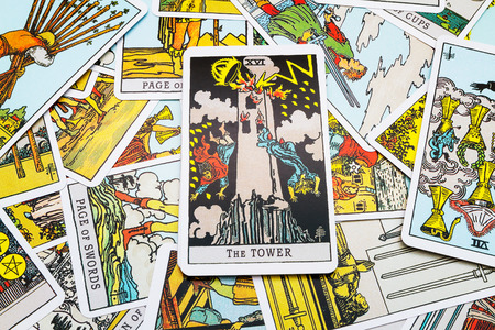 parapsychology: Tarot cards Tarot, the tower card in the foreground.