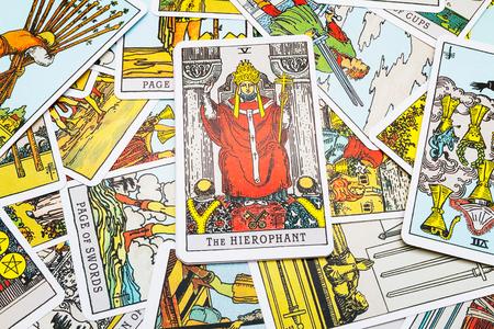 cartomancy: Tarot cards Tarot, the hierophant  card in the foreground. Stock Photo