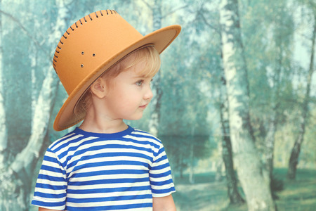 white girl: Little girl playing in cowboy brown hat. Stock Photo