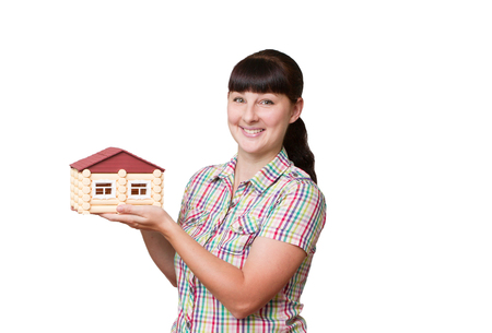 modell: Young woman holding home isolated on a white background. Stock Photo
