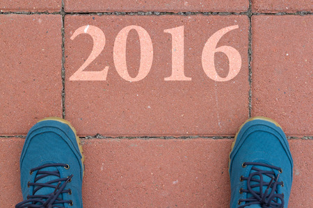 Start to new year 2016  top view of  man walking on the road