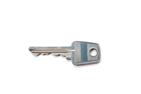 lock and key: Key to the door lock isolated on white background.