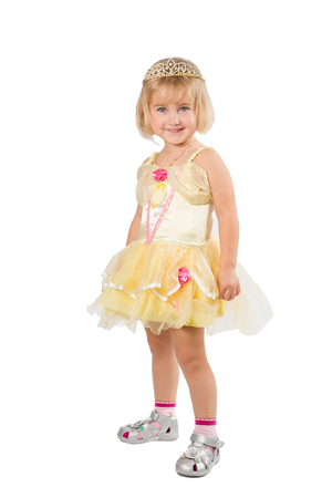 prom queen: Little girl in a beautiful yellow dress and crown isolated on white background. Stock Photo