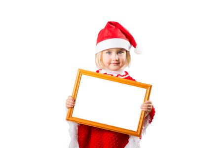 baby girl: Little girl in hat Santa Claus holding frame with a white background for the text. Stock Photo