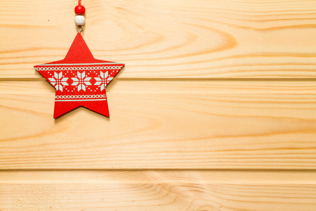 red snowflake background: Beautiful Christmas wooden background decorated with a toy.