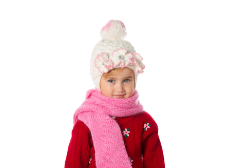 ponytails: Little girl with ponytails in a warm hat and red sweater isolated on a white background