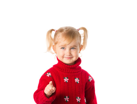 ponytails: Little girl with ponytails in a warm red sweater isolated on a white background.