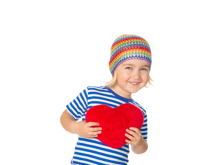 day valentine: Little girl holding a red heart toy. Isolated on a white background.