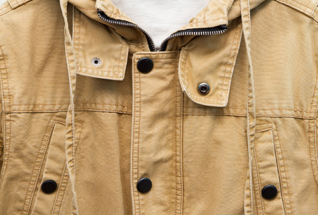shoulder buttons: Brown autumn cotton jacket. closeup. texture button Stock Photo