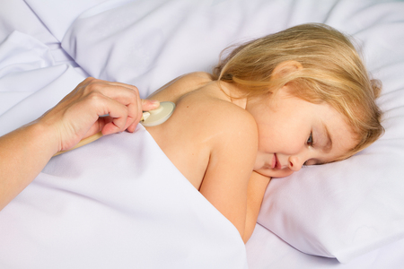 doctor examine: Pediatric doctor examine little girl with stethoscope. Virus, flu, cold, fever. Stock Photo