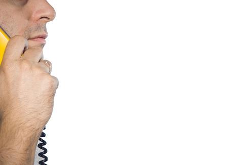 phonecall: Caucasian man talking on a landline phone.Yellow handset.