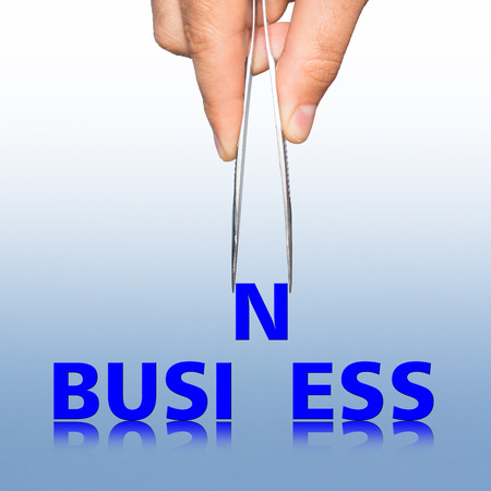 pinzas: Hand with tweezers and word business , business concept Foto de archivo