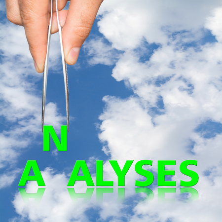 analyses: Hand with tweezers and word Analyses  business concept