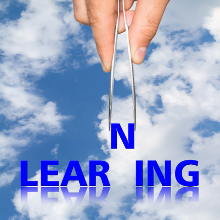forceps: hand with  forceps and  word learning. business concept
