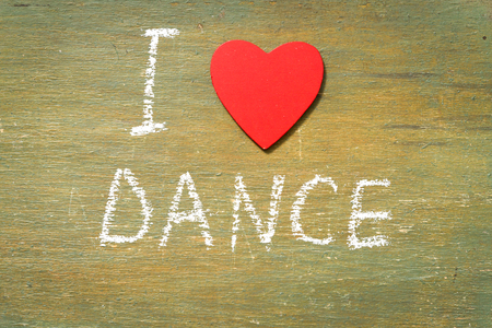 Text i love dance written with chalk in old board wooden.