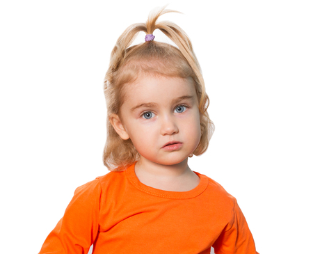 agitated: Little Funny girl in orange blouse. Isolated on white background