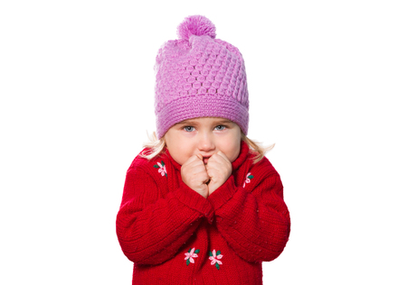 Little Funny girl in cap and red sweater. Isolated on white background