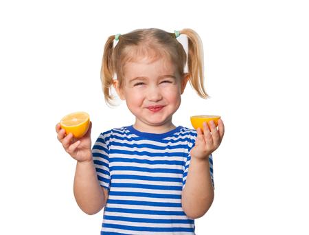 Little Funny girl in striped shirt  keeps lemons. Isolated on white background