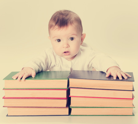 early childhood education: Baby, infant and Books, Kids Early Childhood Education Development, Smart Child Preschool Reading Concept, isolated on Background. Stock Photo