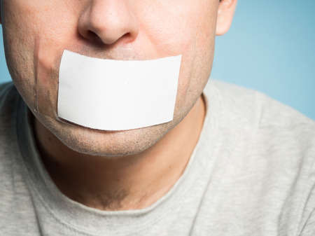 human mouth: Caucasian man with duct tape on mouth, white . Conceptual image.