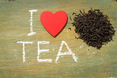 i love: Text i love tea written with chalk in old board wooden. Stock Photo